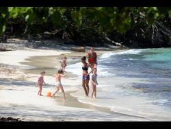 Tourists enjoy the beach.