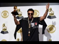 AP Shaggy poses in the press room with the award for Best Reggae Album for '44/876' at the 61st annual Grammy Awards at the Staples Center on February 10 in Los Angeles.