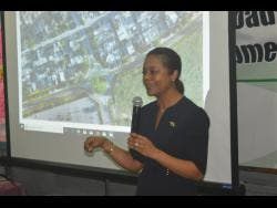 Marlene Malahoo Forte speaks during a community-consultation meeting on the Montego Bay Perimeter Road project at the Howard Cooke Primary School in Catherine Hall, St James, last Wednesday.