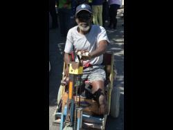 Oswald Davis in his three-wheel cart.