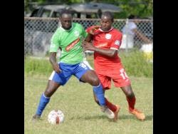 Dino Williams (left) from Montego Bay United getting the better of Ricardo Dennis (right) from Boys' Town in a Red Stripe Premier League match last season.
