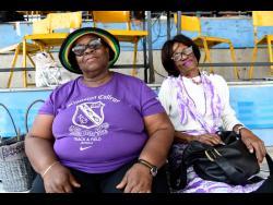 Jean Sutherland (left) and Evritta Gardner  at the National Stadium yesterday.