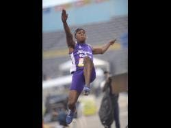 Wayne Pinnock of Kingston College setting a new Boys' Champs record of 8.05 metres in the  Class One boys long jump at the National Stadium yesterday.
