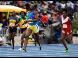 Ashanti Moore (second right) of Hydel High wins the Class One Girls 200m final at the ISSA/GraceKennedy Boys and Girls' Athletics Championships on Saturday, March 30, 2019.