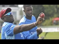 Coach Roddy Estwick (left) and Test and one-day international captain Jason Holder during a Windies training session at the Kent County Cricket Club Ground in Canterbury.