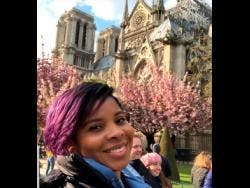 Simone Hull in front of Notre Dame Cathedral before the fire.