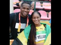 Sprinter Briana Williams (right) and coach Ato Boldon.