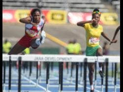 Daszay Freeman (left) of The Queen's School wins Heat Three of the Class One Girls 100m hurdles ahead of Vere Technical High School's Roxan Foster at the 2018 ISSA/GraceKennedy Boys and Girls' Athletics Championships.