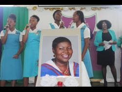 Members of William Knibb School choir sing in tribute to the memory of their late principal, Alcia Morgan-Bromfield.
