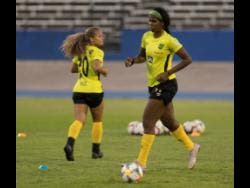 Khadija Shaw (right) at a Reggae Girlz training session held at the National Stadium yesterday, ahead of an international friendly match against Panama this Sunday. Also pictured is newcomer Madiya Harriott.