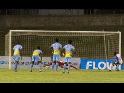 Portmore United's Javon East (right) scoring a penalty giving his side an early lead against Waterhouse FC in the 2019 FLOW Concacaf Caribbean Club Championship match at Stadium East in Kingston last night.