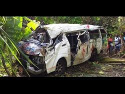 The ill-fated bus that crashed along the Black Hill main road in Portland yesterday, killing one student and injuring 26 persons.