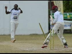 Davion Wilson from Yallahs looks back as his stumps go flying after he was bowled by Keith Edwards during the Social Development Commission (SDC) T20 Cricket Competition at the Goodyear Oval in St Thomas on Sunday, May 26, 2019.