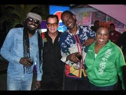 Legendary dancehall artistes Beenie Man (left) and Bountry Killer (second right) hang out with Joe Bagdonovich (second left), chief organiser of Reggae Sumfest, Nadia Kiffin-Green, marketing manager, J. Wray and Nephew Limited, at Downsound headquarters on Belmont Road, Kingston, on Wednesday, May 29.