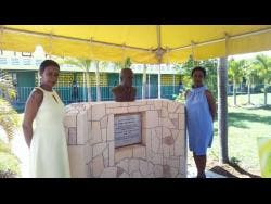 Dr Karen Francis (left) and Francine Francis Chin, daughters of the late Ben Francis, stand by his bust.