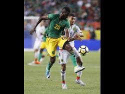 Jamaica's Kemar Lawrence (left) challenges Mexico's Orbelin Pineda for the ball during a Concacaf Gold Cup match in Denver, Colorado, in 2017.