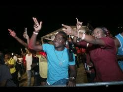 Patrons react to a selection at the Guinness Sounds of Greatness first round held in Ocho Rios.