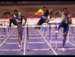 From left: Shane Brathwaite of Barbados finishing second in 13.37 seconds ahead of Hansle Parchment sixth in 13.68 seconds and winner Ronald levy in 13.33 seconds  at the Racers Grand Prix, held at the National Stadium on Saturday.