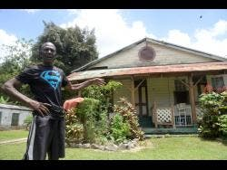 Michael 'Fox' Hutchinson says the railway house behind him has been occupied by his family for five decades.