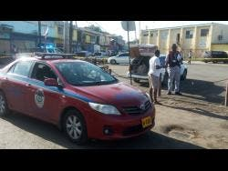 A joint police/military team on the scene at the Charles Gordon Market in Montego Bay, St James, where two armed gunmen attacked a male vendor yesterday morning, and shot him multiple times.