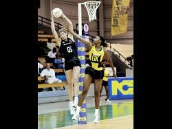 New Zealand's goal shooter, Irene Van Dyk, catches the ball while she is defended by Jamaica's goalkeeper, Nicole Aiken at the National Indoor Sports Centre on Thursday, October 22, 2009.