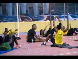 Shorn Hector/Photographer Members of Jamaica's national senior netball team, the Sunshine Girls, stretch during a recent training session at the Leila Robinson Courts at the National Stadium.