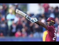 West Indies batsman Nicholas Pooran gestures to celebrate scoring a century during the Cricket World Cup match against Sri Lanka at the Riverside Ground in Chester-le-Street on Monday.