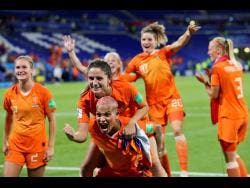 Dutch players celebrate after winning the FIFA Women's World Cup semi-final match against Sweden at the Stade de Lyon outside Lyon, France, yesterday.