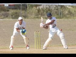 Batsman Andre McCarthy (right) of Junction Ballards Valley in action against Junction Bull Savannah during the St Elizabeth parish final of the SDC/Wray & Nephew National T20 Competition at the Manley Horne Sports Park on Sunday.