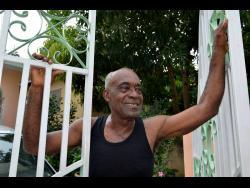 Garnett Smith smiles as he talks about the joys of living near the beach in Whitehouse, Westmoreland.