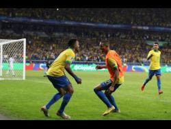 Brazil's Gabriel Jesus (left) celebrates with Richarlison his side's second goal scored by teammate Roberto Firmino (right) during a Copa América semi-final match against Argentina on Tuesday.