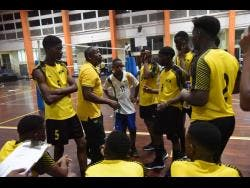Jamaica Under-19 Men's Volleyball coach Steve Davis gives his team instructions during the Caribbean Zonal Volleyball Association Youth Tournament at the GC Foster College in St Catherine on Monday.