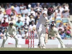 Windies opener John Campbell, of Jamaica, plays a straight drive off the bowling of England pacer James Anderson during day one of the first Test at Kensington Oval in Bridgetown, Barbados, on Wednesday, January 23. Campbell made 44.