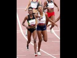 Natoya Goule of Jamaica (left), and Deborah Rodriguez of Uruguay finish first and third, respectively, in the women's 800m final at the Pan American Games in Lima, Peru, yesterday.