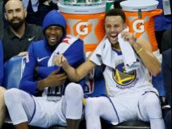 In this Nov. 22, 2017, file photo, Golden State Warriors forward Kevin Durant (left) and guard Stephen Curry (right) laugh on the bench during the third quarter of the team's NBA basketball against the Oklahoma City Thunder in Oklahoma City.