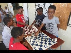 These children engage in a game of chess.
