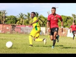 Renoir Elliott (left) of Vere FC battles with Romario Witter of Downs FC  during their JFF All-Island Confederation Play-Offs encounter at the Wembley Centre Of Excellence in Hayes, Clarendon, on Sunday, June 3.