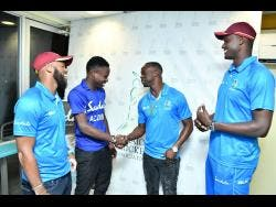West Indies Test players John Campbell (left), Kemar Roach and Jason Holder (right) greet Jamaica Under-19 cricket captain Kirk McKenzie at Sabina Park on Wednesday.