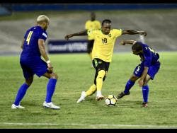 File  Jamaica striker Darren Mattocks (centre) weaves his way between Tyler Lee (left) and Jermaine Wilson, of the Cayman Islands, during a Concacaf Nations League game at the National Stadium on Sunday, September 9, 2018.