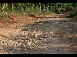 The roads in Gutters Mount, St Catherine, are in a poor state.
