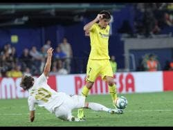 Villareal's Gerard Moreno controls the ball past Real Madrid's Luka Modric during the Spanish La Liga match between the teams in the Ceramica stadium in Villarreal, Spain, on September 1, 2019.