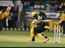 Jamaica Tallawahs batsman Andre Russell is floored by a short ball from St Lucia Zouks' Hardus Viljoen.
