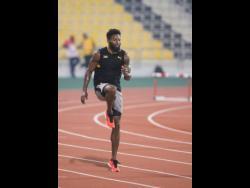 National sprinter Rasheed Dwyer in training at the Qatar Sports Club in Doha, Qatar, on Tuesday.