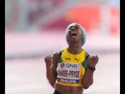 Shelly-Ann Fraser-Pryce celebrates after capturing the gold medal in the women's 100 metres final at 2019 IAAF World Championships in Doha, Qatar, yesterday.