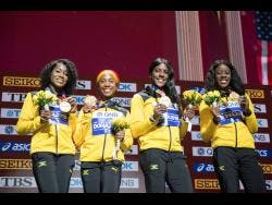 Members of Jamaica's female sprint relay team with their IAAF World Championships gold medals. From left: Natalliah Whyte, Shelly Ann Fraser-Pryce, Jonielle Smith, and Shericka Jackson.
