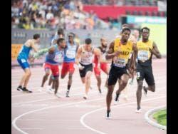 Demish Gaye (second right) running the final leg of the men's 4x400m relay after collecting the baton from Terry Thomas. Jamaica won a silver medal.