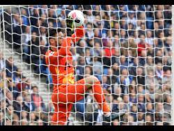 Tottenham's goalkeeper Hugo Lloris makes a save during the English Premier League match between Brighton and Hove Albion and Tottenham Hotspur  last Saturday.