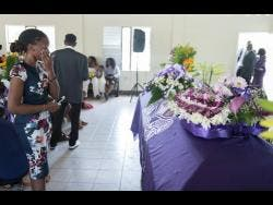 Fredrina Grey pays her respects to he dearly departed fried, Twayne Crooks.