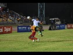 Frome Technical's Anthony Scott (right) is challenged by Cornwall College's Solano Birch during an ISSA/WATA DaCosta Cup semi-final match at the Montego Bay Sports Complex last season. Frome Technical are confident of getting back to this stage of the competition after a 5-0 win over Petersfield High School yesterday.