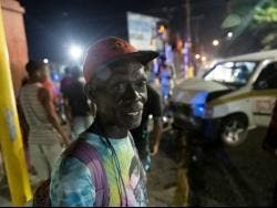 Michael Wilson was seated in the front seat of the Toyota  Probox taxi as it collided with a Nissan Bluebird motor car at the intersection of North and East streets in Kingston, last night.